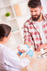 doctor treats workers compensation hand injury